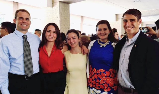 A group of five students from Khayrullina's neuroscience class of 2016 in a crowded room.