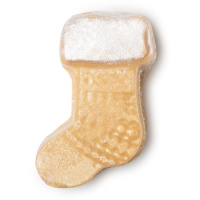 A sock shaped light brown bath oil with a white trim on the top on a bright background