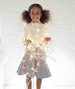 Girl holding holiday lights