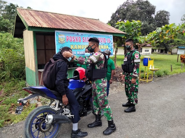 Satgas Yonif 512/QY Jadi Motivator Pendisiplinan Prokes Covid-19 Di Ujung Timur Indonesia