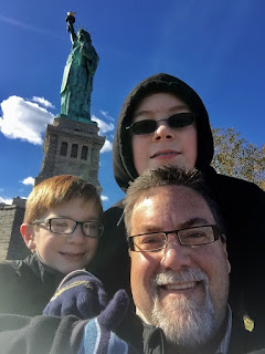 David brodosi and family at the Statue of Liberty