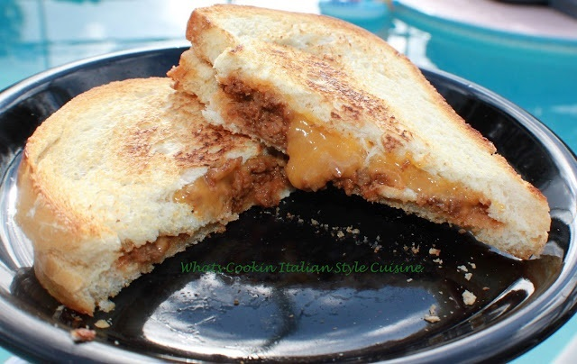 this is a old fashioned 1950s style sloppy joe made into grilled cheese using all ingredients from scratch on a black plate