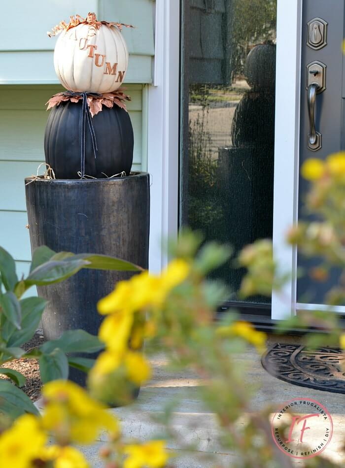 A non-traditional twist for making stacked pumpkin topiaries for fall with painted faux pumpkins and unique copper elements to flank your front door.