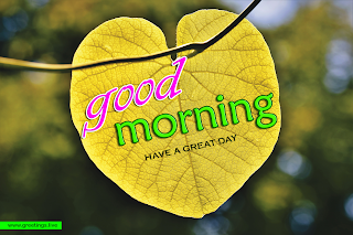 Creative greetings with good morning wishes on heart shaped yellow leaf