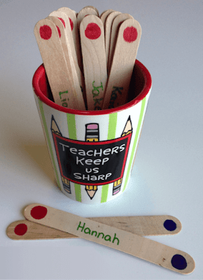 """Photo of student selector sticks in a cup that says, """"Teachers Keep Us Sharp."""""""