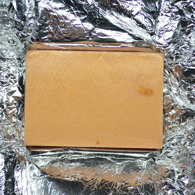 champagne soap bar on top of foil wrapping