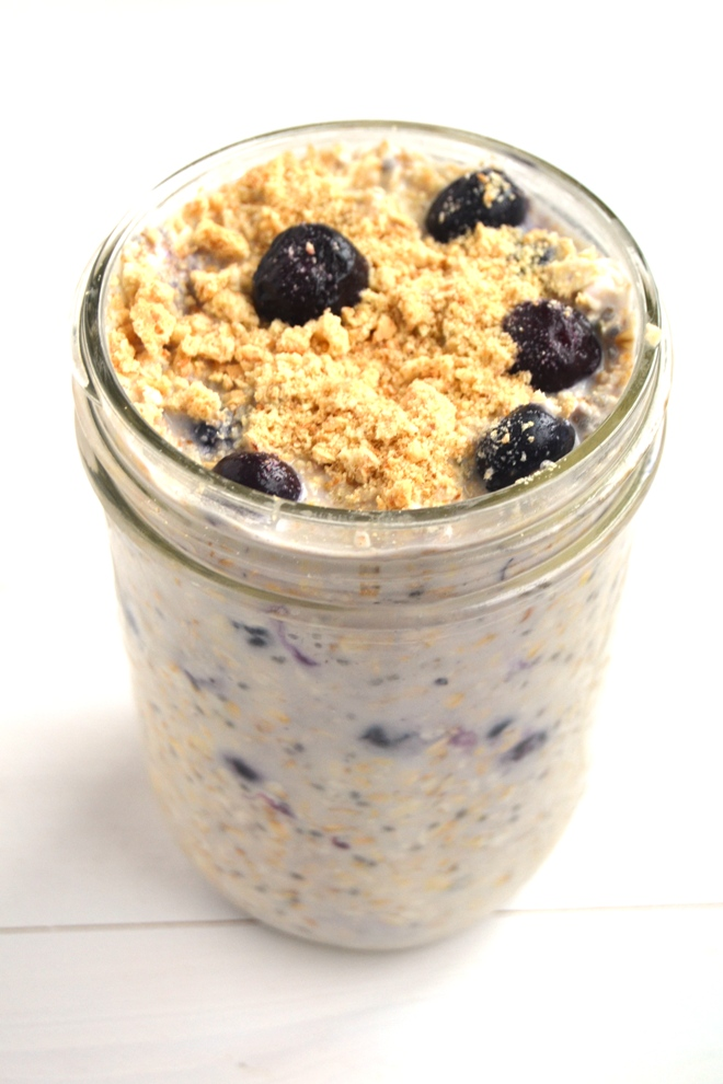 Blueberry Cheesecake Overnight Oats taste like your favorite dessert but are healthy with oats, Greek yogurt and blueberries! Loaded with swirls of cream cheese and graham crackers for a true cheesecake flavor.