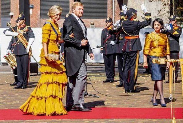 Queen Maxima wore a yellow dress from Claes Iversen Haute Couture SS17 collection. Bottega Veneta intrec knot clutch