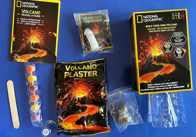 The contents of the Build Your Own Volcano set from National Geographic by Bandai UK includes plaster, a mould, paint, citric acid, sodium bicarbonate, a geode and a pumice