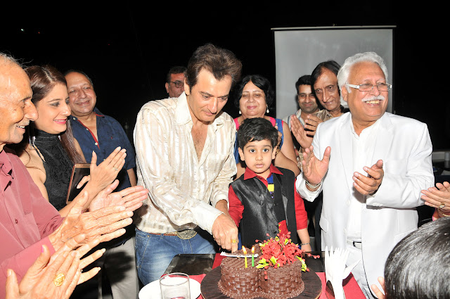 Avinash Wadhawan & Son Samraat Cutting Cake With Family