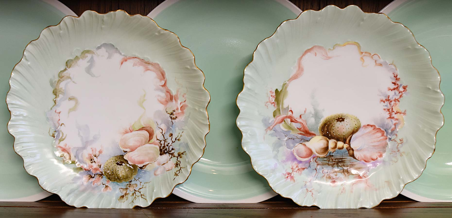 Limoge Handpainted Shell plates