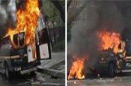 violent demonstrators set fire to vehicles