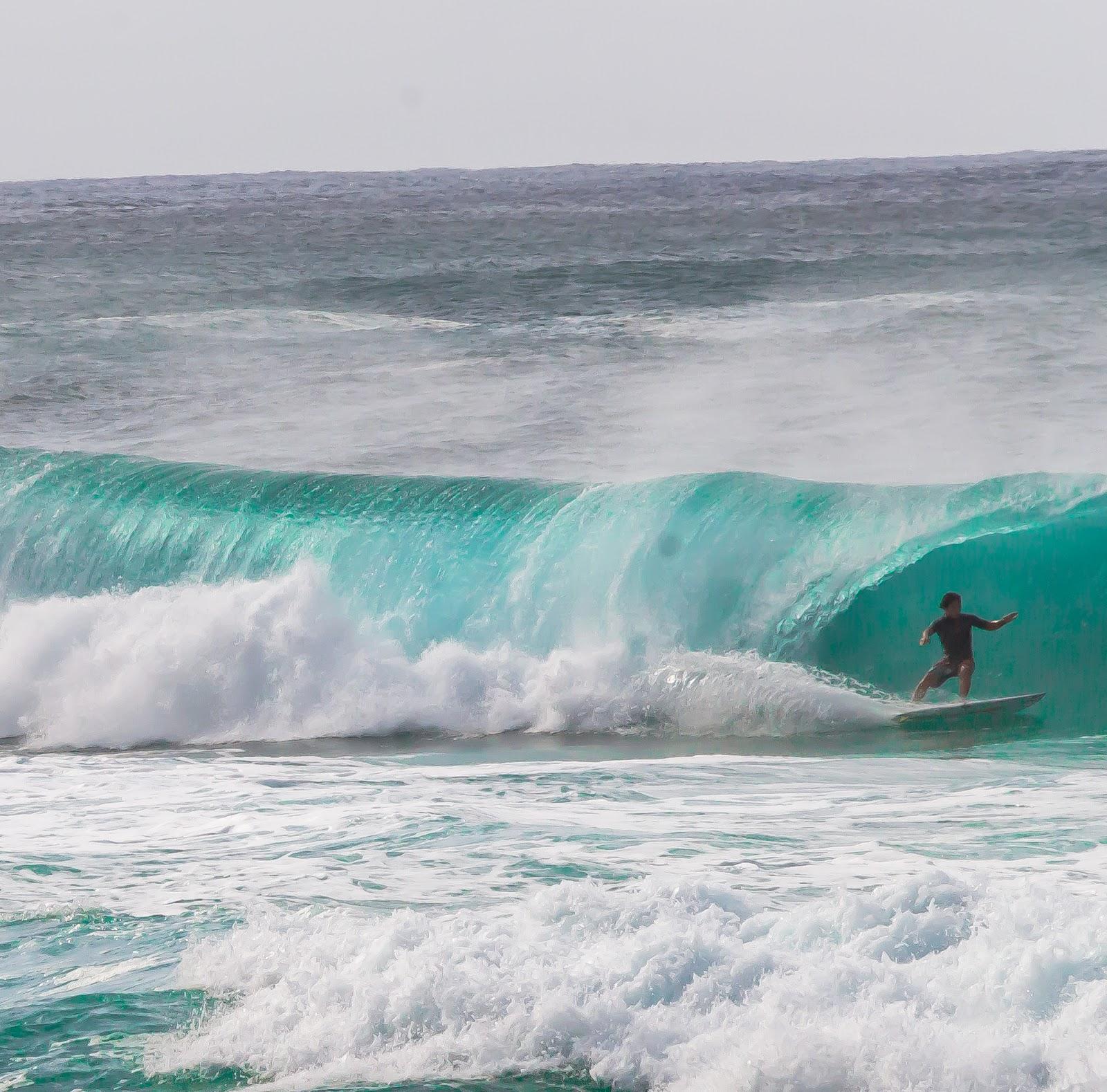 Surfer in Banzai Pipeline