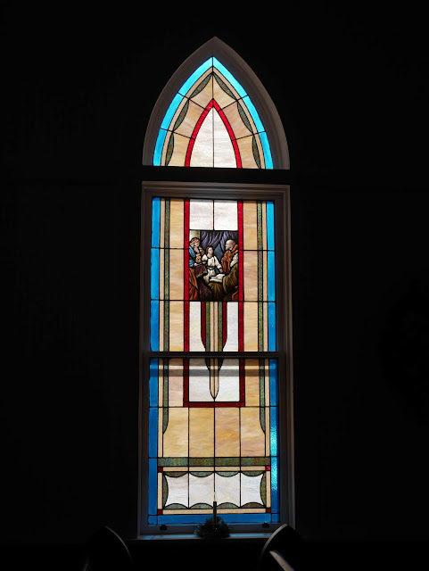 a stained glass window inside the church