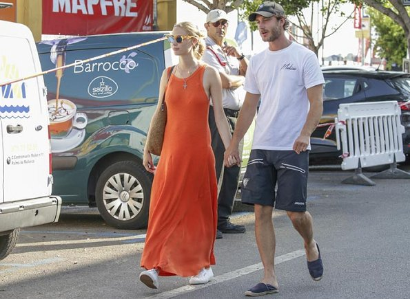 Pierre Casiraghi and Beatrice Borromeo in Palma de Mallorca. Beatrice Borromeo wearing a orange maxi dress