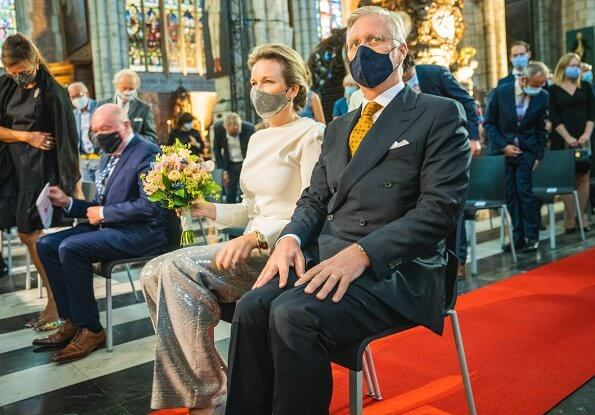 Queen Mathilde wore a new sequined Prince of Wales checked wool straight-leg pants, and white cashmere round neck sweater