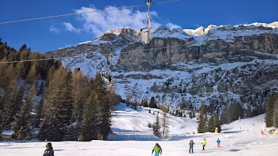 Skiing near Arabba with the Sella Massif in the background.