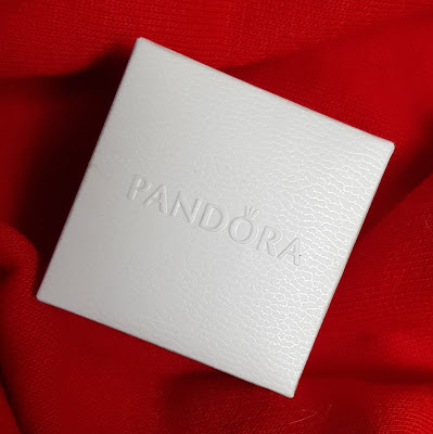 Pandora small white jewellery box with earrings inside