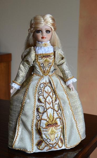 Golden dress for porcelain doll.