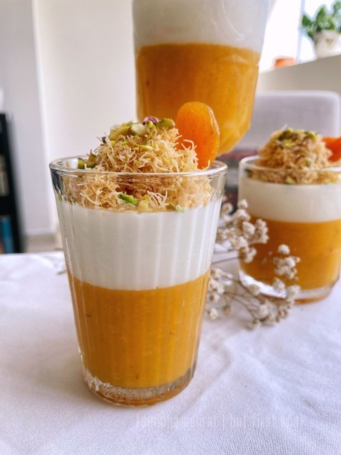 Milk and Apricot Fruit Leather Pudding served in three different sized serving bowls garnished with kunafe and pistachios