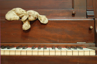 Photo of toy on piano by Julia Freeman-Woolpert