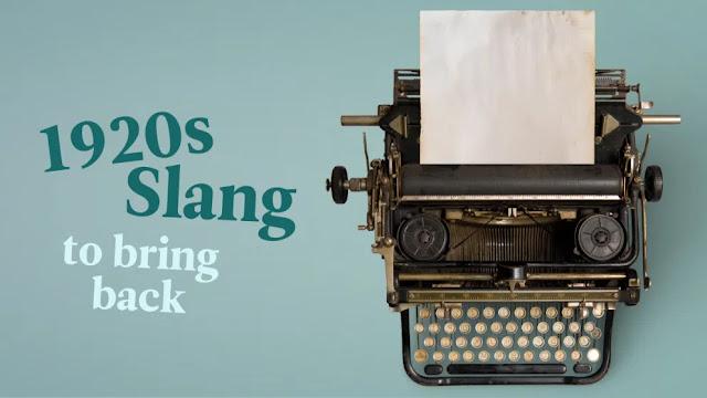 Typewriter showing the words slang