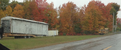 Old Trailer and Bus on the Side of the Road in Maine in Autumn