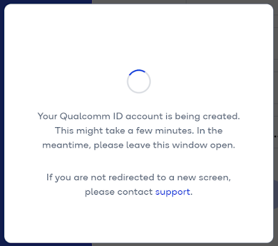 An in-page popup with a spinner, and text explaining that it might take a few minutes for the account to be created, and that the window must be kept open.