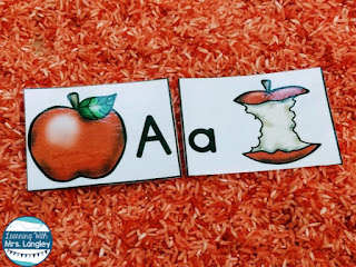 Sensory bins are a great way to incorporate play in your kindergarten or preschool centers. These apple cards are fun to hunt in a sensory bin full of fun rice! This blog post includes step by step directions on how to make easy sensory bin rice with materials you probably have at home! Throw in a few fun items from the Dollar Store and this is an easy DIY project. #kindergartenclassroom #preschoolclassroom #kindergarten #prek