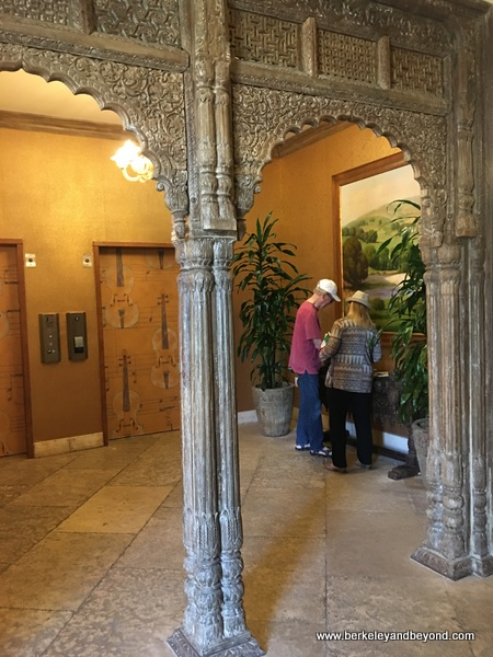 repurposed ancient doorway by elevators at Allegretto Vineyard Resort in Paso Robles, California