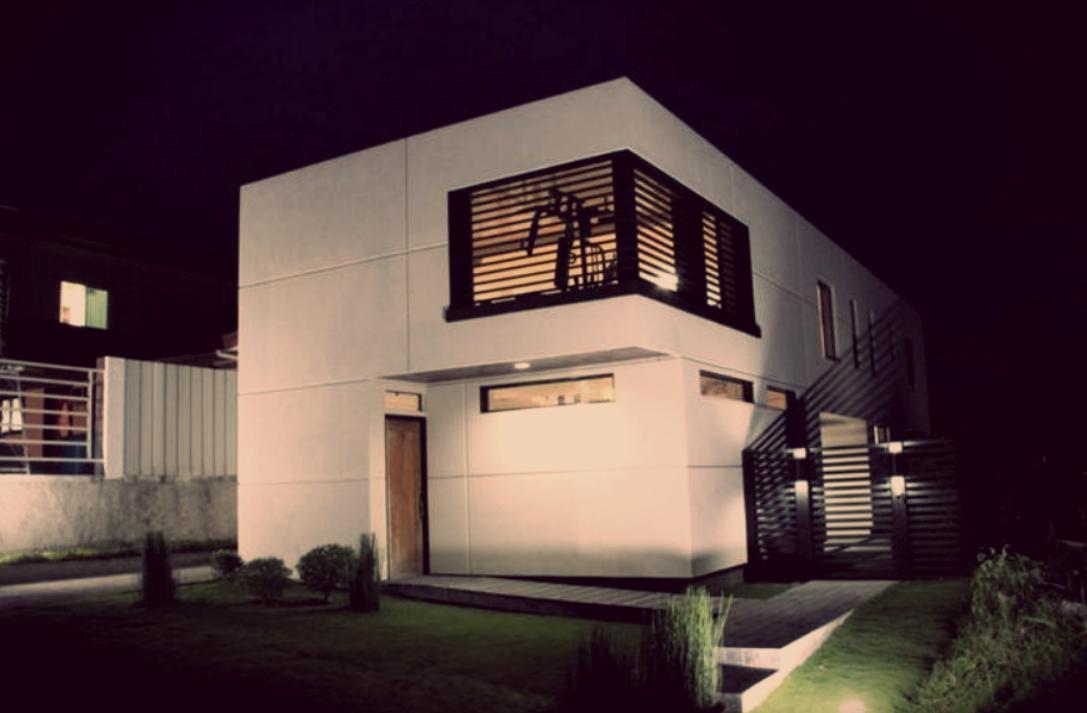 rumah minimalis sederhana dengan teralis besi pada jendela