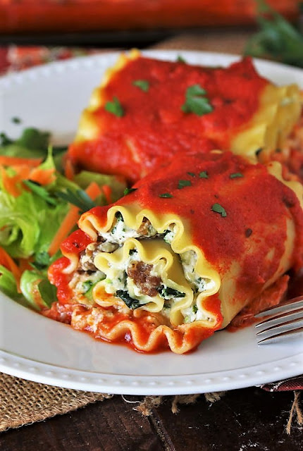 Plate of Spinach Lasagna Roll-Ups with Sausage Image