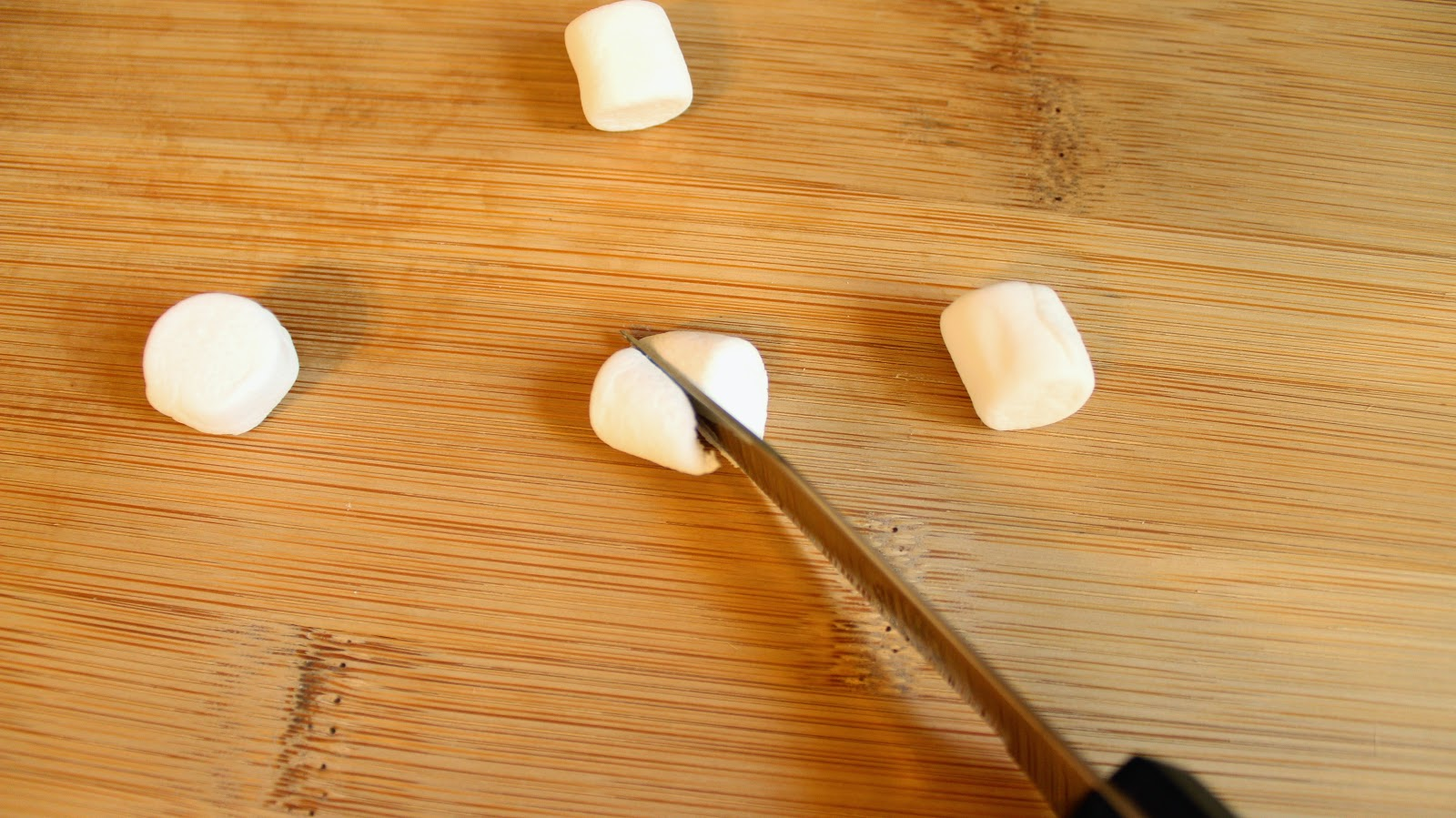 Knife cutting marshmallow
