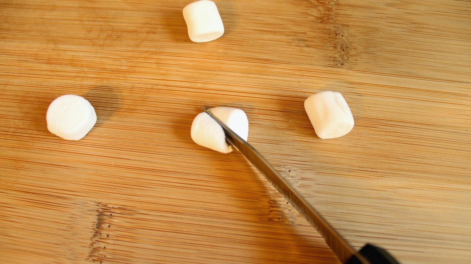Knife cutting marshmallow
