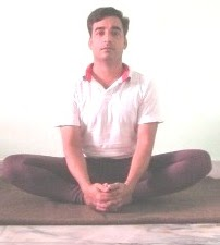 A man in butterfly pose of yoga
