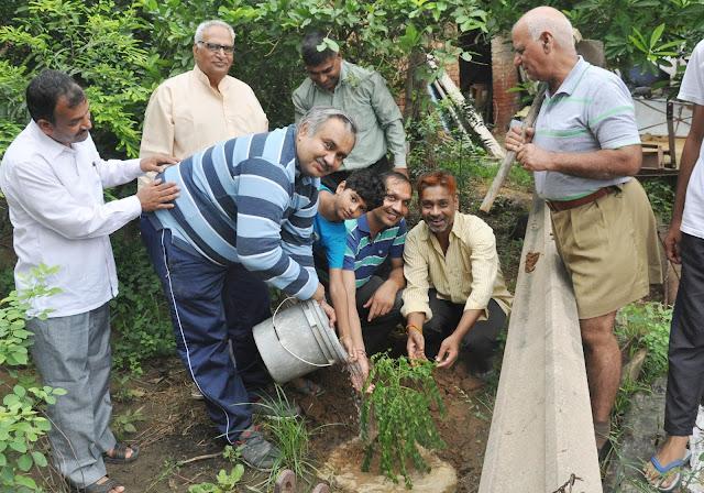 JC Bose YMCA Registrar, Dr. Sanjay Sharma, a Yoga class of Leigh villagers, plantation done