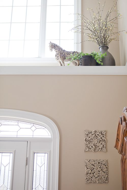 delicious decor  How to decorate a high ledge in a front foyer