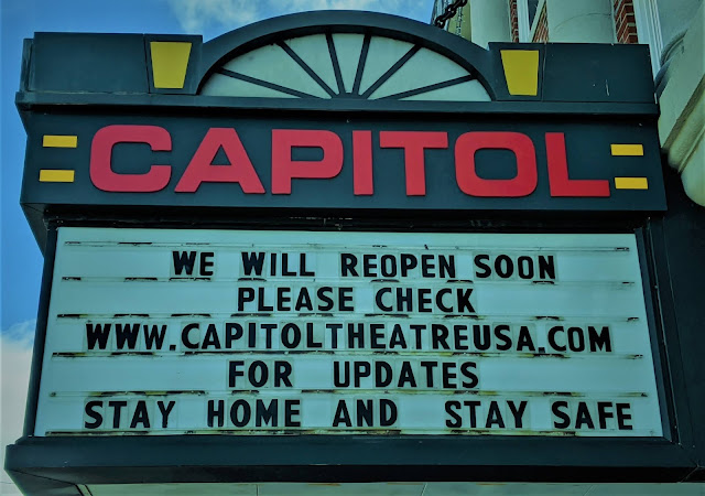 "A sign at the Capitol Theater that was ""We will reopen soon. Please check capitoltheatreusa.com for updates. Stay home and stay safe."""