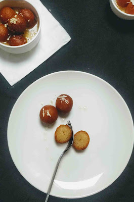 Serving gulab jamun with nuts for gulab jamun recipe