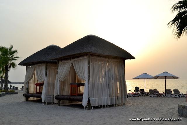 Cabana by the beach at The Cove Rotana