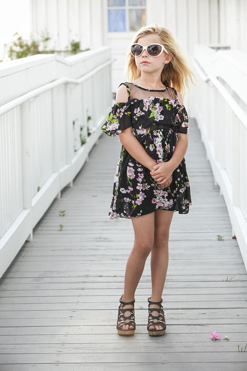 Sienna striking a pose in this floral tunic