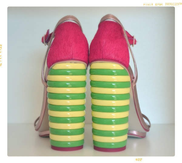 back view of ASOS Walls Twister heeled sandals green and yellow striped heels