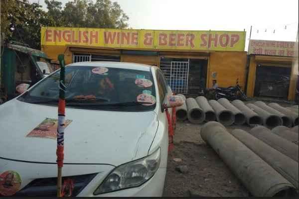 bjp-candidate-narendra-gupta-car-seen-on-sharab-theka-news