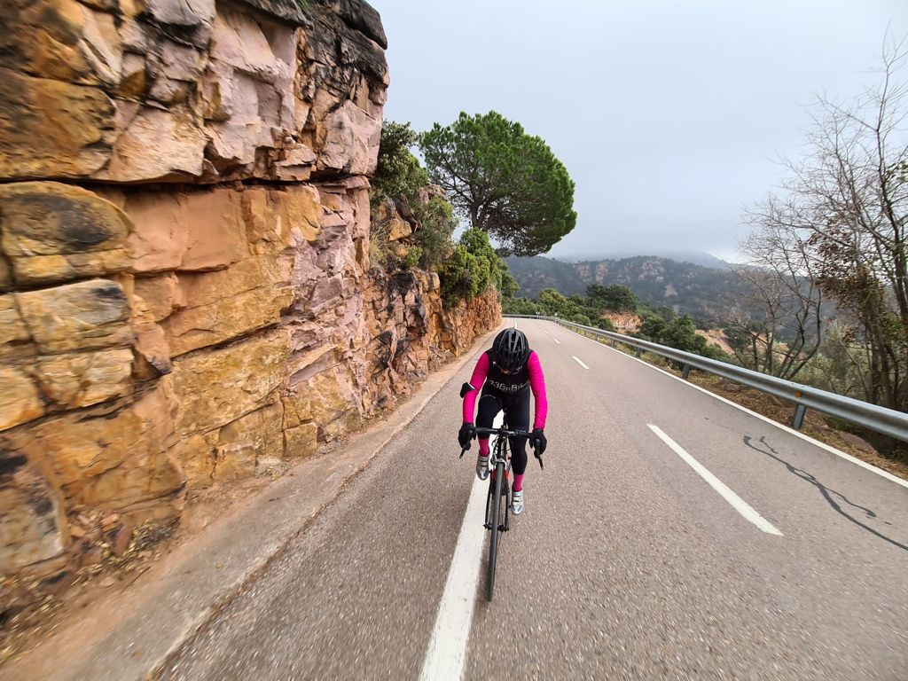 Cyclist climbing Puerto de Eslida, Castellon, Spain