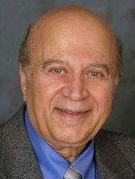 Headshot of a balld, middle-aged white man