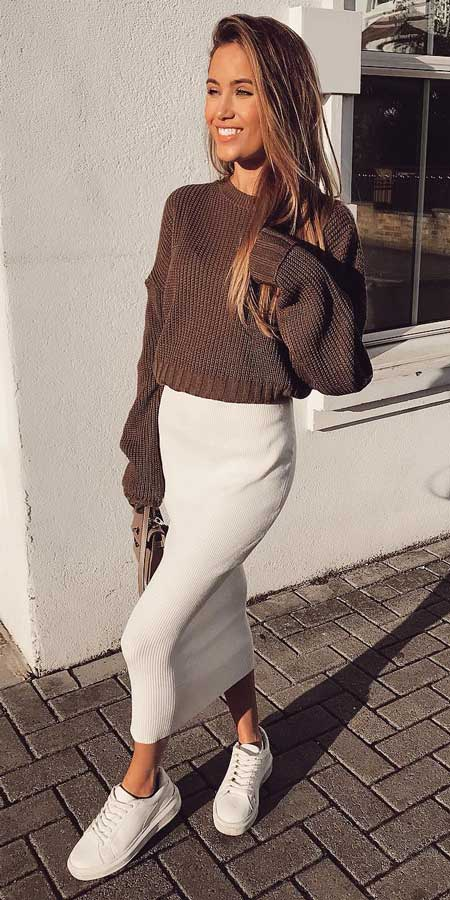Brown ribbed knitted jumper, knit midi skirt, chunky trainer | From knited jumpers to oversized jumper. Discover these 31 Cute womens jumpers that will totally embrace you. Jumper Outfits via higiggle.com #jumper #winterwear #style #cute