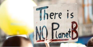 There is no Planet B' written on a sign