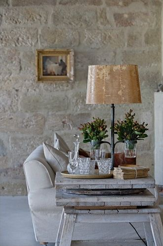 Home decor inspiration: limestone wall in #Frenchfarmhouse living room with rustic elegance on Hello Lovely Studio