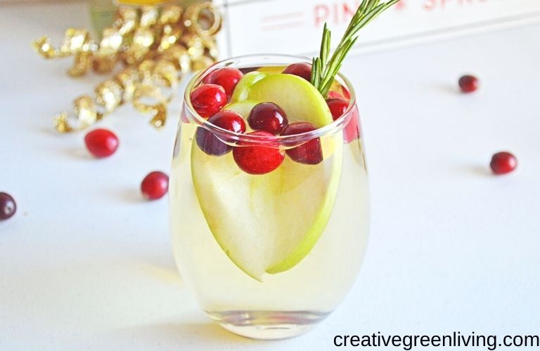 Sparkling white wine sangria with apples and cranberries