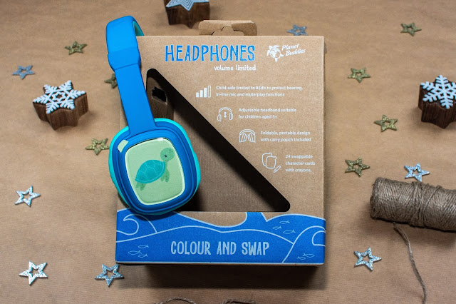 Blue children's headphones with a window on the ear piece and a picture of a tortoise slotted in.
